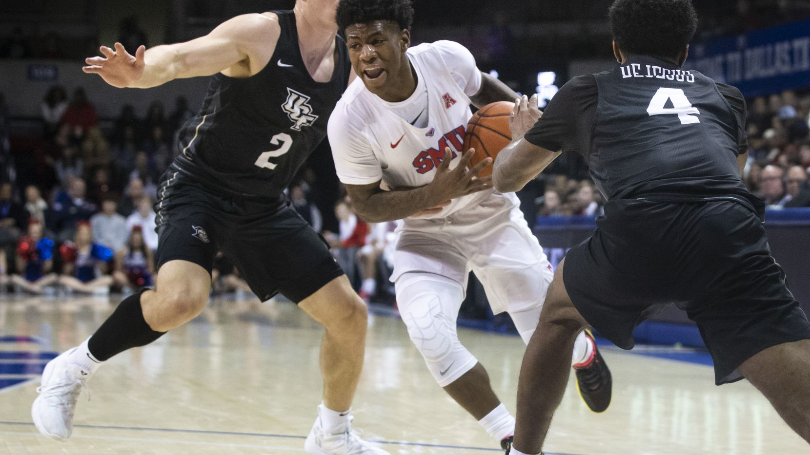 Southern Methodist Mustangs guard Kendric Davis (3) drives past UCF Knights guard Matt Milon (2) in the first half of an NCAA basketball game between the SMU Mustangs and the University of Central Florida Knights at Moody Coliseum in University Park, Texas, on Wednesday, Jan. 8, 2020.