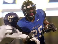 Trophy Club Byron Nelson running back Maxwell Modeste (25) is unable to elude the tackle of Keller Timber Creek defensive back Matthew Malick (14) during a first half rush. The two teams played their District 5-6A football game at Northwest ISD Stadium in Justin on October 17 2019.