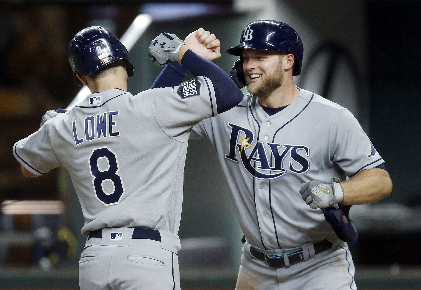 Tampa Bay Rays Brandon Lowe (8) is congratulated by teammate Austin Meadows after scoring him on a two-run homer against the Los Angeles Dodgers during the fifth inning in Game 2 of the World Series at Globe Life Field in Arlington, Wednesday, October 21, 2020. (Tom Fox/The Dallas Morning News)