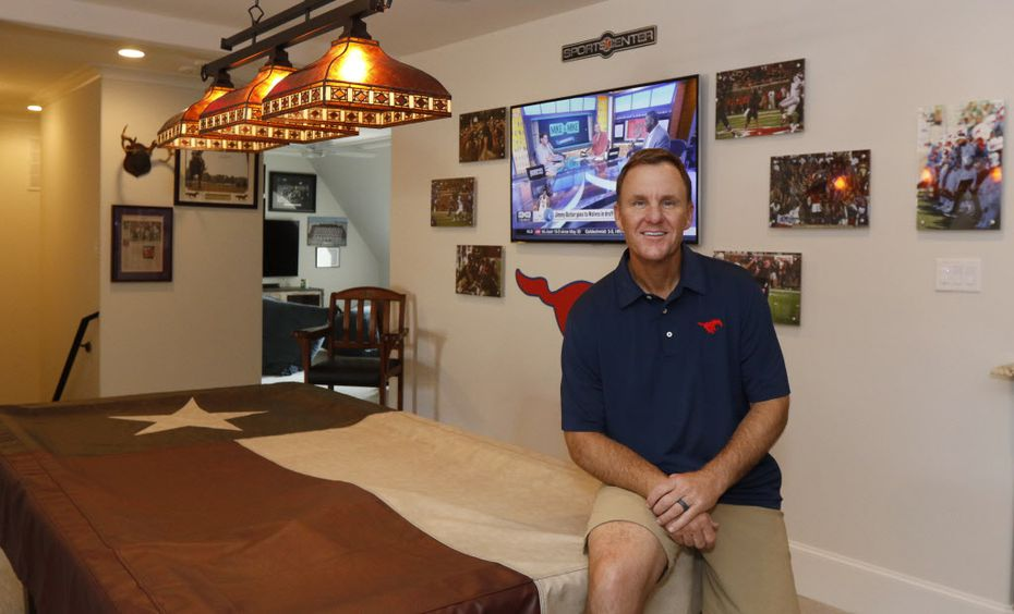 SMU head football coach Chad Morris poses for a portrait in his recruitment room in his home in Highland Park, Texas on Friday, June 23, 2017.