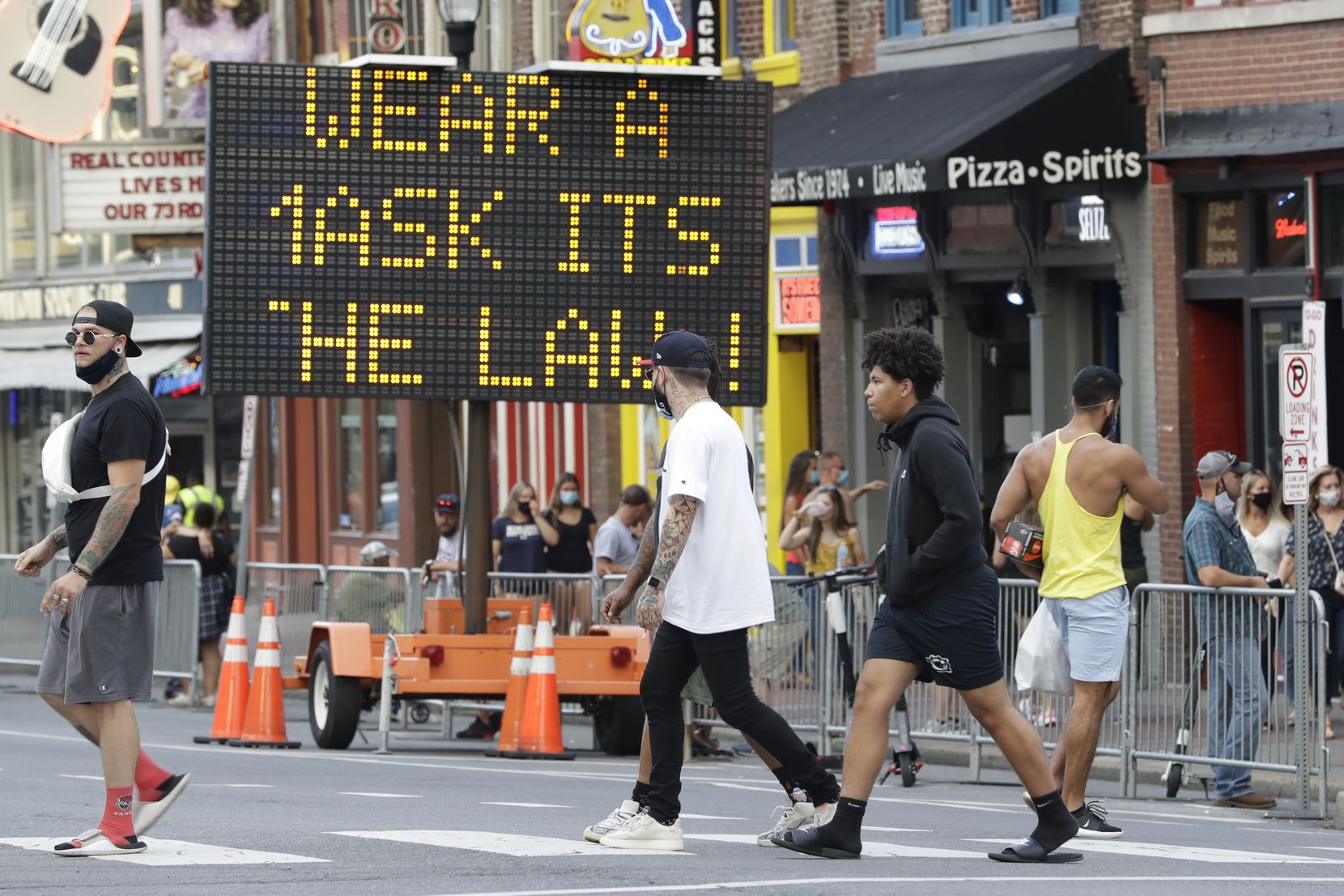 A sign encouraged the wearing of masks in downtown Nashville last August.