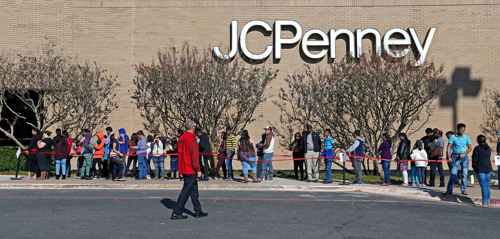 Shoppers stay in line to enter the J. C. Penney store at Collin Creek Mall in Plano, Texas, Thursday, Nov. 23, 2017.