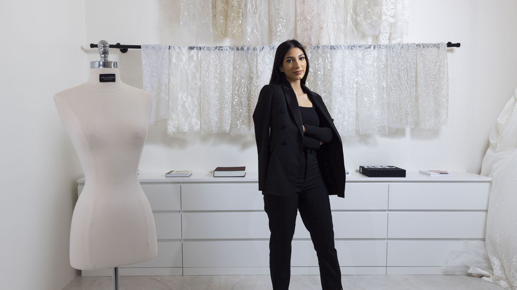 Designer Dina Hawidi poses for a photo at her boutique in July.