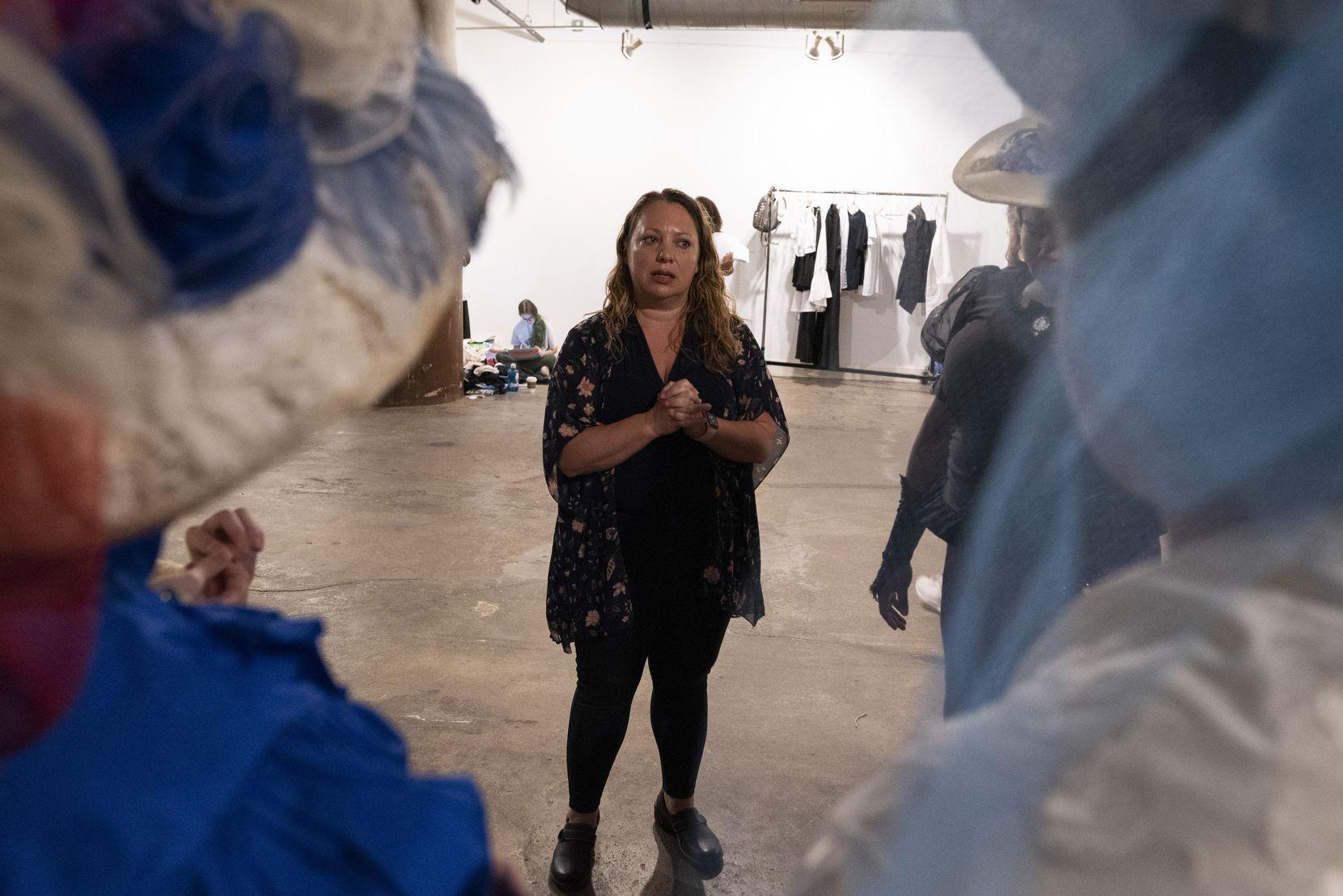 Cry Havoc Theater Company founder Mara Richards Bim talks to the teen cast at a rehearsal.
