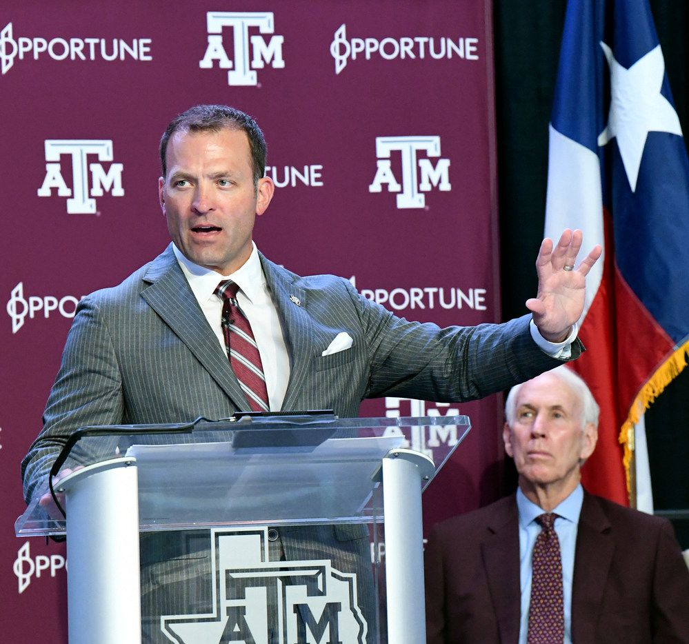 New Texas A&M athletic director Ross Bjork, left, addresses media and A&M athletic staff in the Hall of Champions in College Station, Texas, Monday, June 3, 2019, as interim athletic director R.C. Slocum, right, looks on. (Dave McDermand/College Station Eagle via AP)