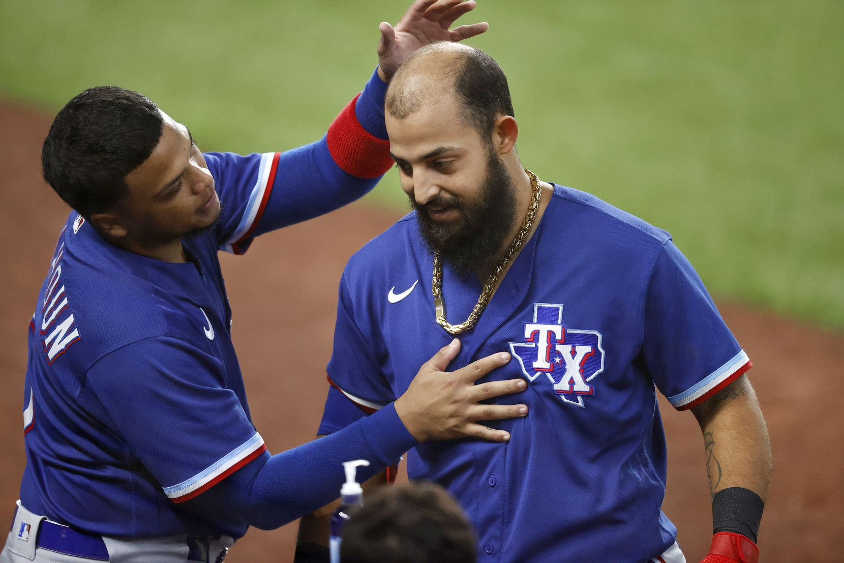 Texas Rangers Rougned Odor (right) is congratulated on his home run by teammate Willie Calhoun during an intrasquad game at Summer Camp inside Globe Life Field in Arlington, Texas, Friday, July 10, 2020. (Tom Fox/The Dallas Morning News)