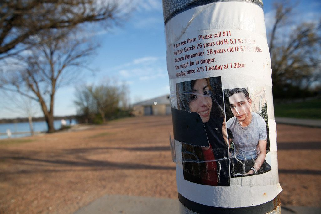 A missing persons flyer for Weltzin Garcia Mireles and Alfonso Hernandez is seen at White Rock Lake in Dallas on March 18, 2019. The pair went missing on Feb. 5.