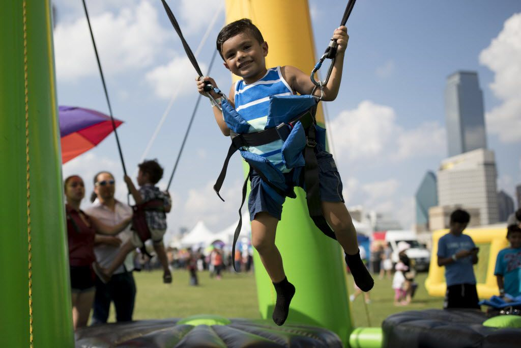 Kain Trejo, 5, of Murphy, Texas plays on the bungee trampoline during La Grande 107.5 Fiestas Patrias at Reunion Park on Sept. 4, 2016 in Dallas.