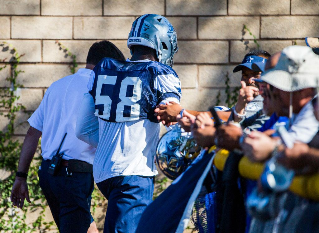 Dallas Cowboys defensive end Robert Quinn (58) leaves practice with a hand injury during an afternoon practice at training camp in Oxnard, California on Tuesday, August 6, 2019. (Ashley Landis/The Dallas Morning News)