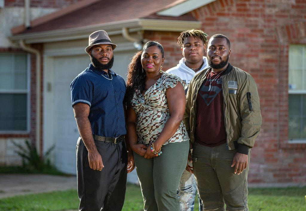 Sammie Anderson with her sons Samuel Bible, 18, left, Ty Anderson, 15, third from left, and Grant Bible at their home in DeSoto.
