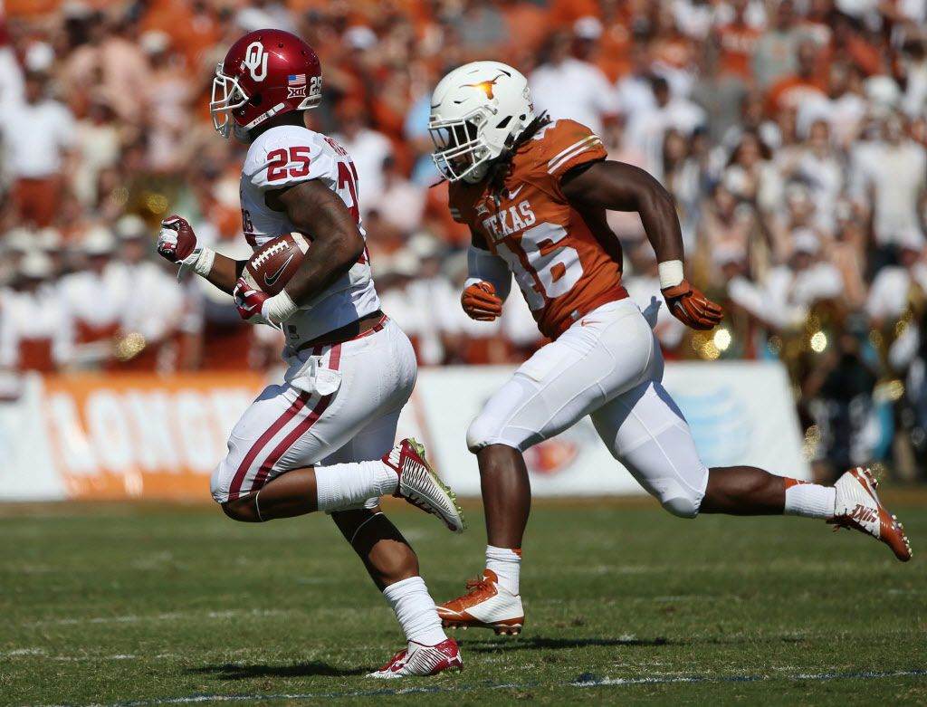 Oklahoma Sooners running back Joe Mixon (25) rushes the ball while being defended by Texas Longhorns linebacker Malik Jefferson (46) in the second quarter during an NCAA football game between Oklahoma and Texas at the Cotton Bowl in Dallas Saturday October 10, 2015. Texas Longhorns beat Oklahoma Sooners 24-17.