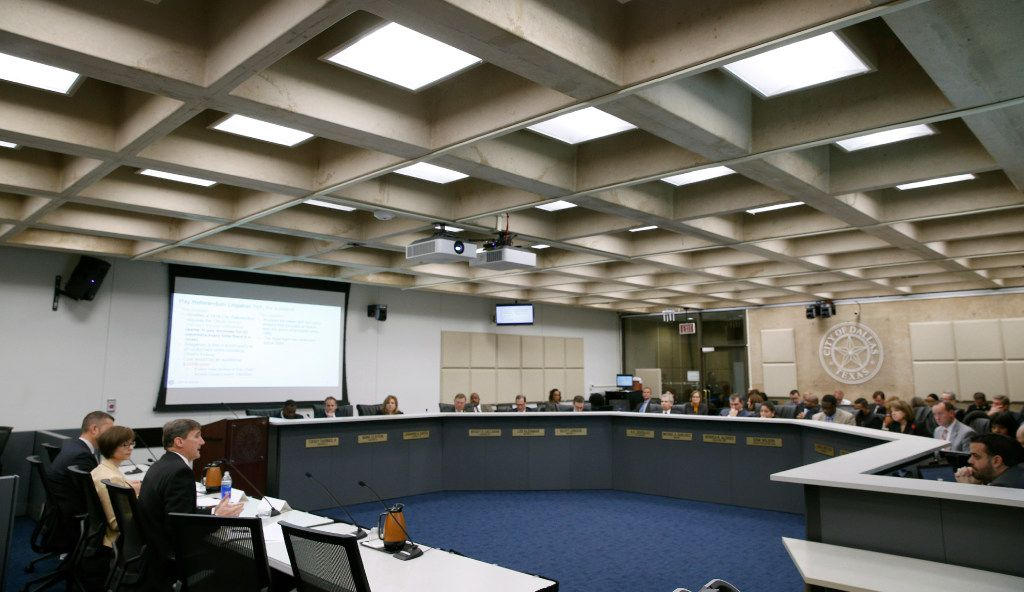 Larry Casto (left seated), city attorney, gives a report of the standing on plans for the future of the Dallas Police and Fire pension structure to Dallas City Council in  December  2016.