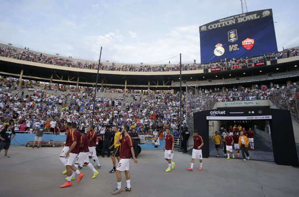 AS Roma players enter the field before the first half of International Champions Cup pre-season soccer game between Real Madrid and AS Roma at Cotton Bowl Stadium in Fair Park in Dallas, Texas on Tuesday, July 29, 2014.  (Brad Loper/The Dallas Morning News)