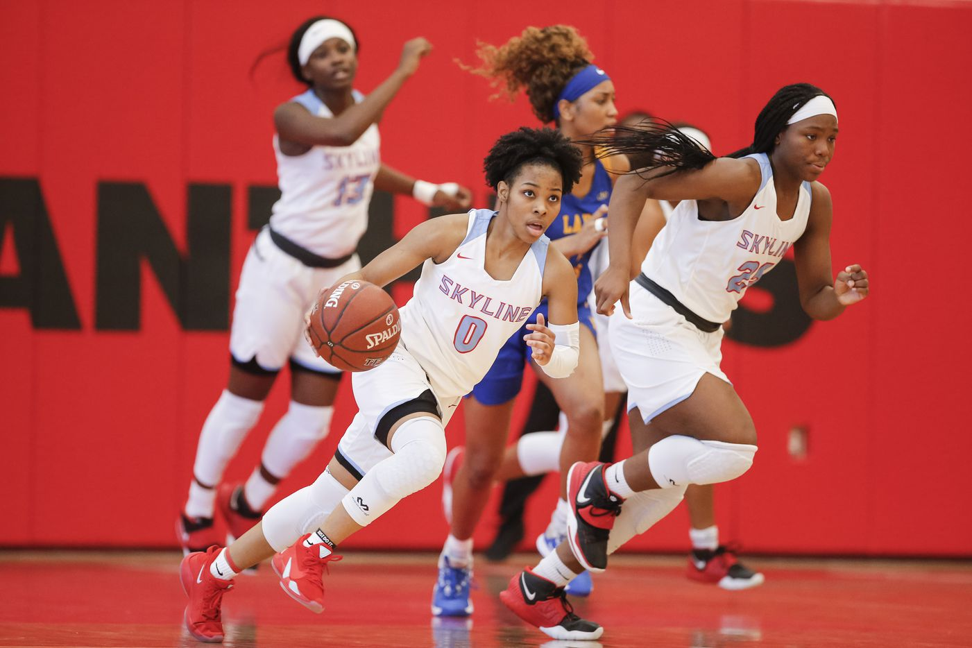 Skyline senior Zyniah Thomas (0) charges up the court during a girls basketball first-round playoff game against Lakeview Centennial at Hillcrest High School in Dallas, Saturday, February 13, 2021. Skyline won 49-42. (Brandon Wade/Special Contributor)
