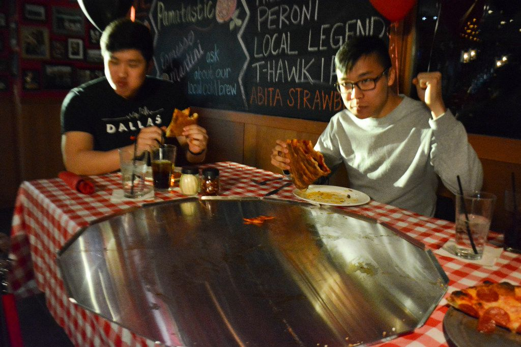 Justin Tak, left and his friend Jacob Rha, came close to finishing the 32-inch pizza in 45 minutes. But alas: Their photos went on the wall of shame.