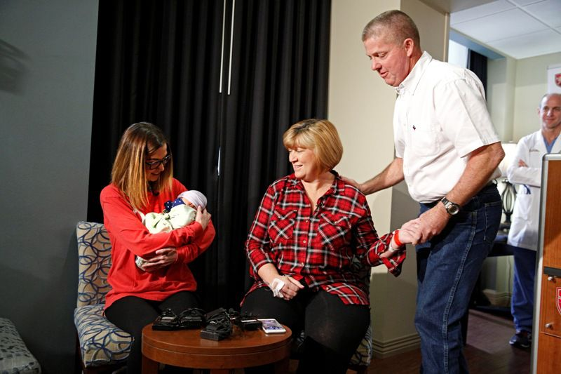 Kelley McKissack (left) holds her baby Kelcey McKissack with their birthmother Tracey Thompson who is a 54-year-old grandmother whom was the surrogate with the grandfather Ben Thompson The Medical Center of Plano in Plano, Texas on January 7, 2016. (Nathan Hunsinger/The Dallas Morning News)