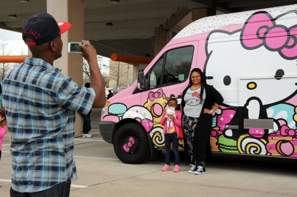 Dakota Bradford and Devon Warner pose for a picture with the famous truck at the Hello Kitty Cafe Truck at The Shops at Willow Bend in Plano, TX on March 12, 2016. (Alexandra Olivia/ Special Contributor)