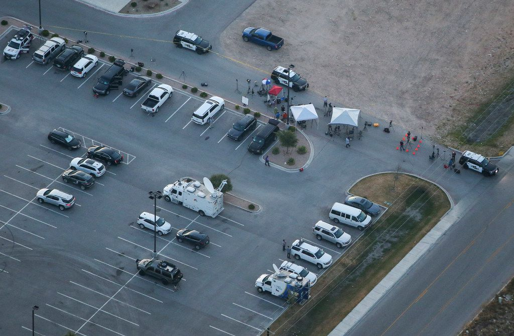 Media and law enforcement are seen Sunday, Sept. 1, 2019 at a Cinergy movie theatre in Odessa, Texas where police took down a gunman Saturday. At least five people died after more than 20 people were shot Saturday when a gunman hijacked a postal truck and began shooting randomly in the Odessa area of West Texas, authorities say.