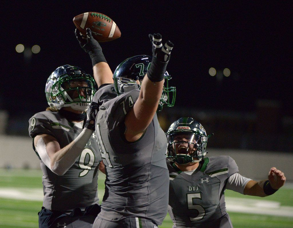 Prosper's Jake Majors (center) celebrates a touchdown reception with teammates Cameron Harpole (9) and Jackson Berry (5) in the first quarter of a high school football game between Plano and Prosper, in Prosper, Texas, Friday, Nov. 8, 2019. (Matt Strasen/Special Contributor)