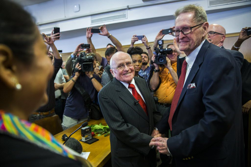 After 54 years as a couple, George Harris, center, and Jack Evans, right, were married by Judge Denise Garcia on June 26, 2015 at the Dallas County Records Building The two were the first gay couple to be issued a marriage license and to be married in Dallas after the U.S. Supreme Court ruled in a 5-4 decision that all states must issue marriage licenses to same-sex couples and recognize marriages performed in another state.