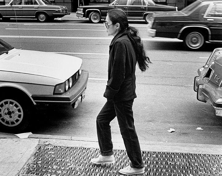 Yoko Ono walks close to the Dakota building in New York City in 1981. (David Woo/Staff Photographer)