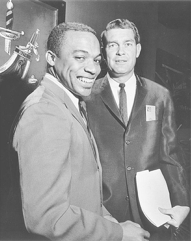 ORG XMIT: *S0405620735* Jerry LeVias (left) was the Southwest Conference Player of the Year in 1968 for coach Hayden Fry (right) at SMU.  DMN Staff file photo, 1966