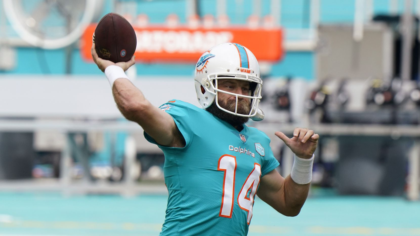 Miami Dolphins quarterback Ryan Fitzpatrick (14) warms up before an NFL football game against the Cincinnati Bengals, Sunday, Dec. 6, 2020, in Miami Gardens, Fla. The Miami Dolphins need a good game Sunday to ensure they get to keep playing, and that's especially true for Tua Tagovailoa. Coach Brian Flores has benched Tagovailoa twice in the fourth quarter, including last week at Las Vegas, when backup quarterback Ryan Fitzpatrick helped Miami overcome a pair of deficits in the final 10 minutes.