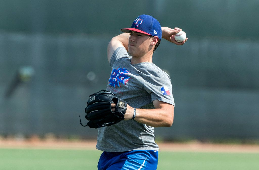 """Texas Rangers' pitcher Cole Winn does a little long toss at Rangers' training facility Thursday, Aug. 9, 2018 in Surprise, Arizona. The players are learning from a program that is designed to hopefully prevent injury, part designed to allow for more learning of """"feel"""" for the game.(Darryl Webb/Special Contributor)"""