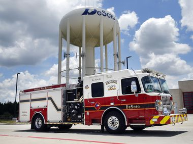 The DeSoto, Texas fire department's Engine 262 is pictured with a city water tower, Wednesday, June 24, 2020.