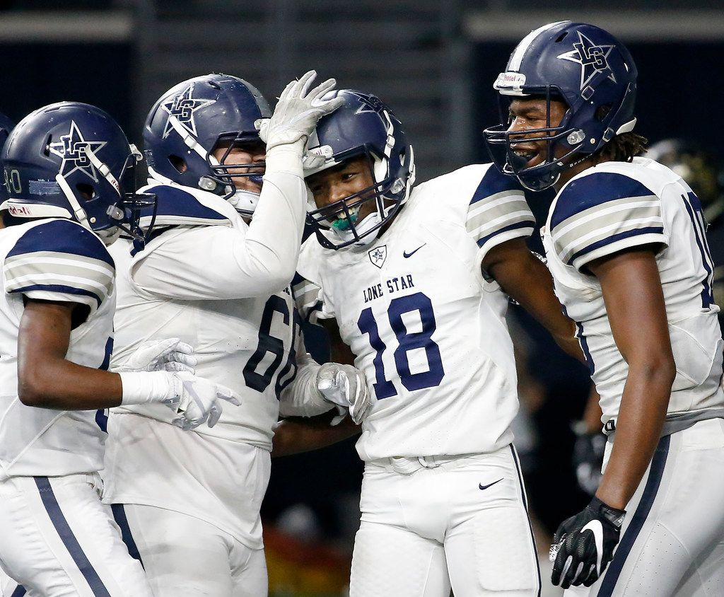 Frisco Lone Star's Marvin Mims (18) is congratulated by Reese Cory (66), Kavika Pittman (10) and Ife Opere (80) after he scores a touchdown against The Colony during the fourth quarter at The Ford Center at The Star in Frisco, Texas, Thursday, Nov. 16, 2017. (Jae S. Lee/The Dallas Morning News)