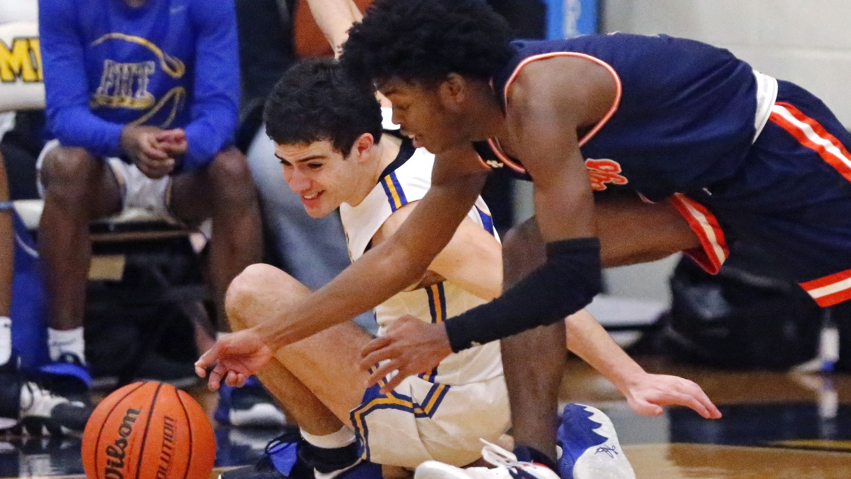 Frisco's Daniel Meneses has the ball stolen by McKinney North's J.J. Henry (right) during the second half of McKinney North's 52-44 bi-district playoff win Monday. (Stewart F. House/Special Contributor)