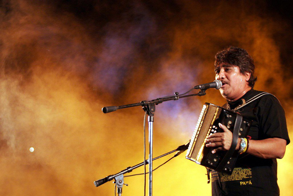 (FILES) In this file photo taken on April 30, 2005, late Mexican musician Celso Pina performs during a concert in Mexico City, on April 29, 2005. - Pina, 66, died at a hospital in Monterrey, Mexico, on Aug. 21, 2019, after suffering a heart attack.