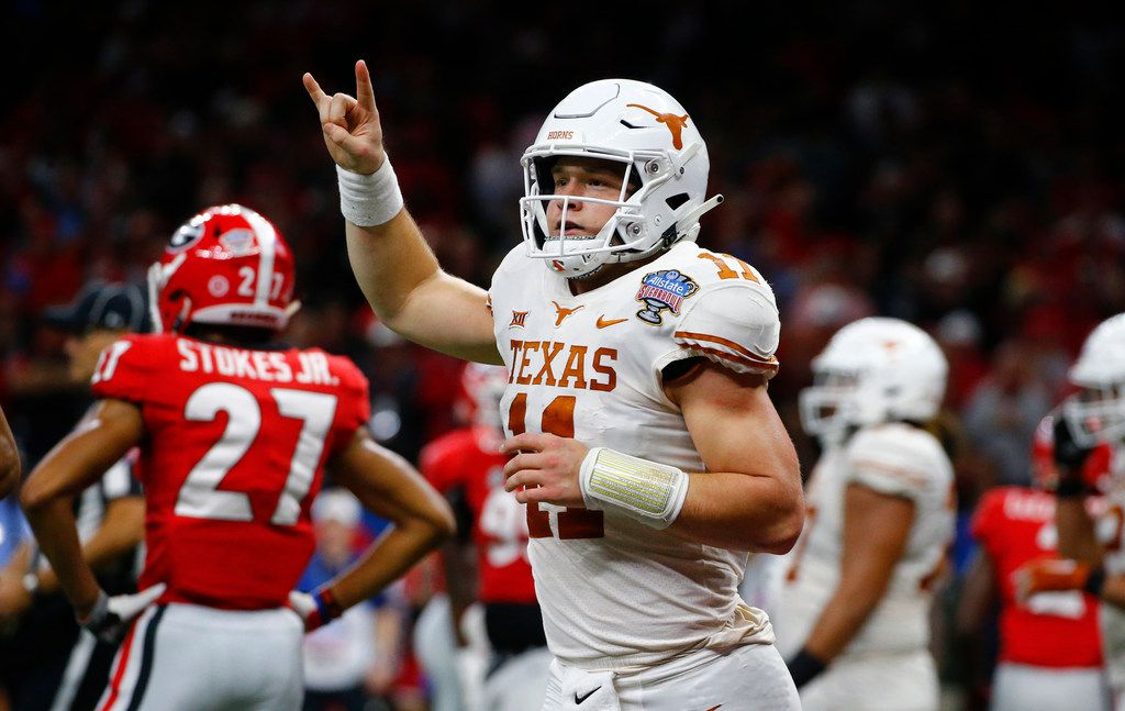 Texas quarterback Sam Ehlinger (11) celebrates his second touchdown carry in the first half of the Longhorns' 28-21 Sugar Bowl win against Georgia in New Orleans on Jan. 1, 2019.