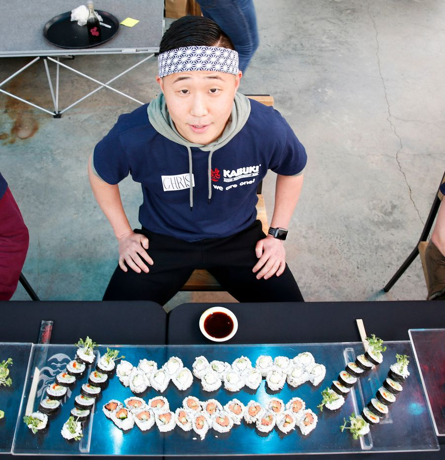 Chris Tak sits with ten sushi rolls in front of him while he waits to compete in the first Sushi Speed Eating Contest at Kabuki Restaurant on Saturday,  April 6, 2019 in Irving, Texas. (Brian Elledge/The Dallas Morning News)
