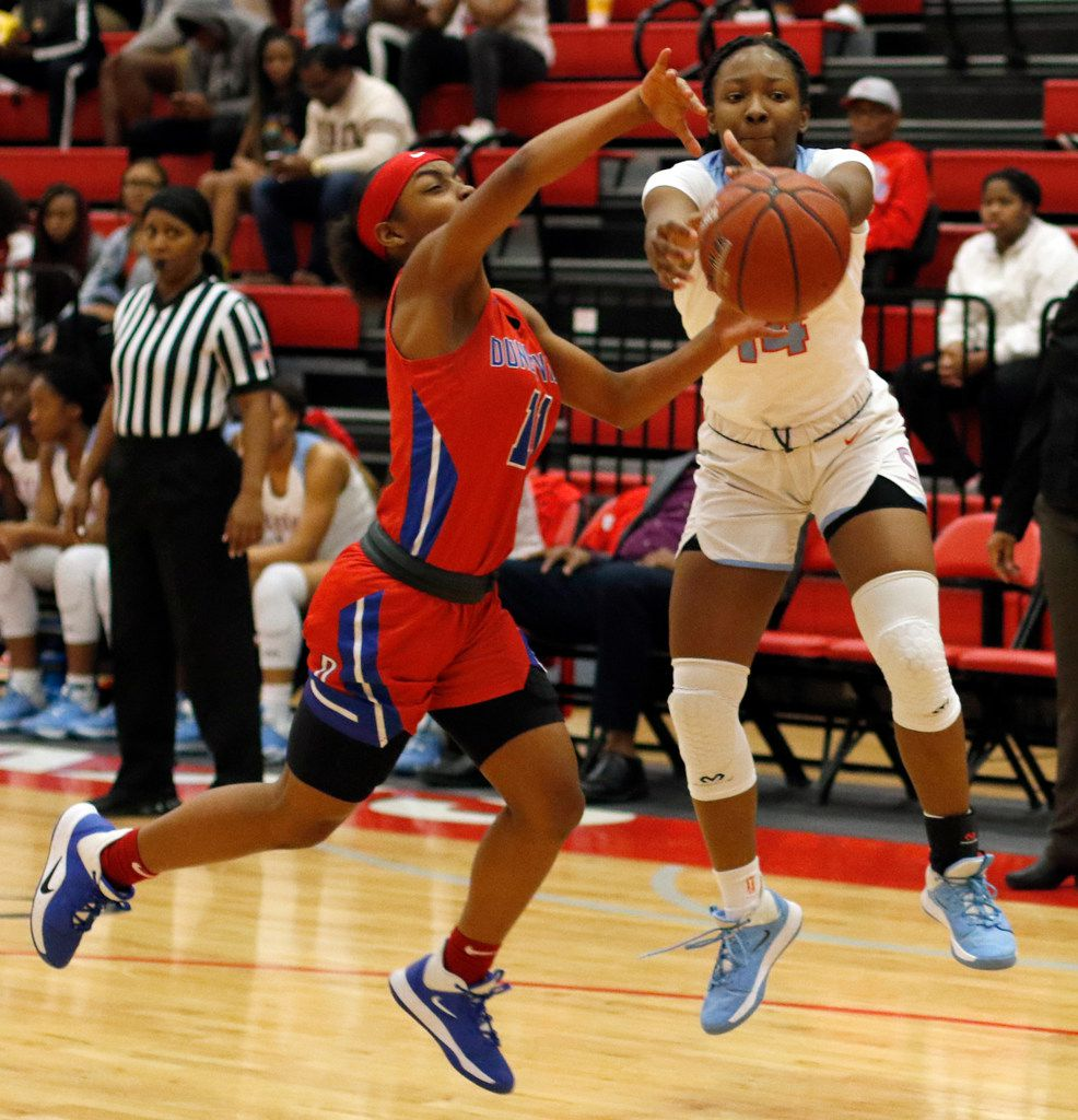 Duncanville's Tristen Taylor (11) battles Dallas Skyline's Daryn Batts (14) for a loose ball during first half action. The two teams played their girls basketball game at  Skyline High School in Dallas on January 7, 2020. (Steve Hamm/ Special Contributor)