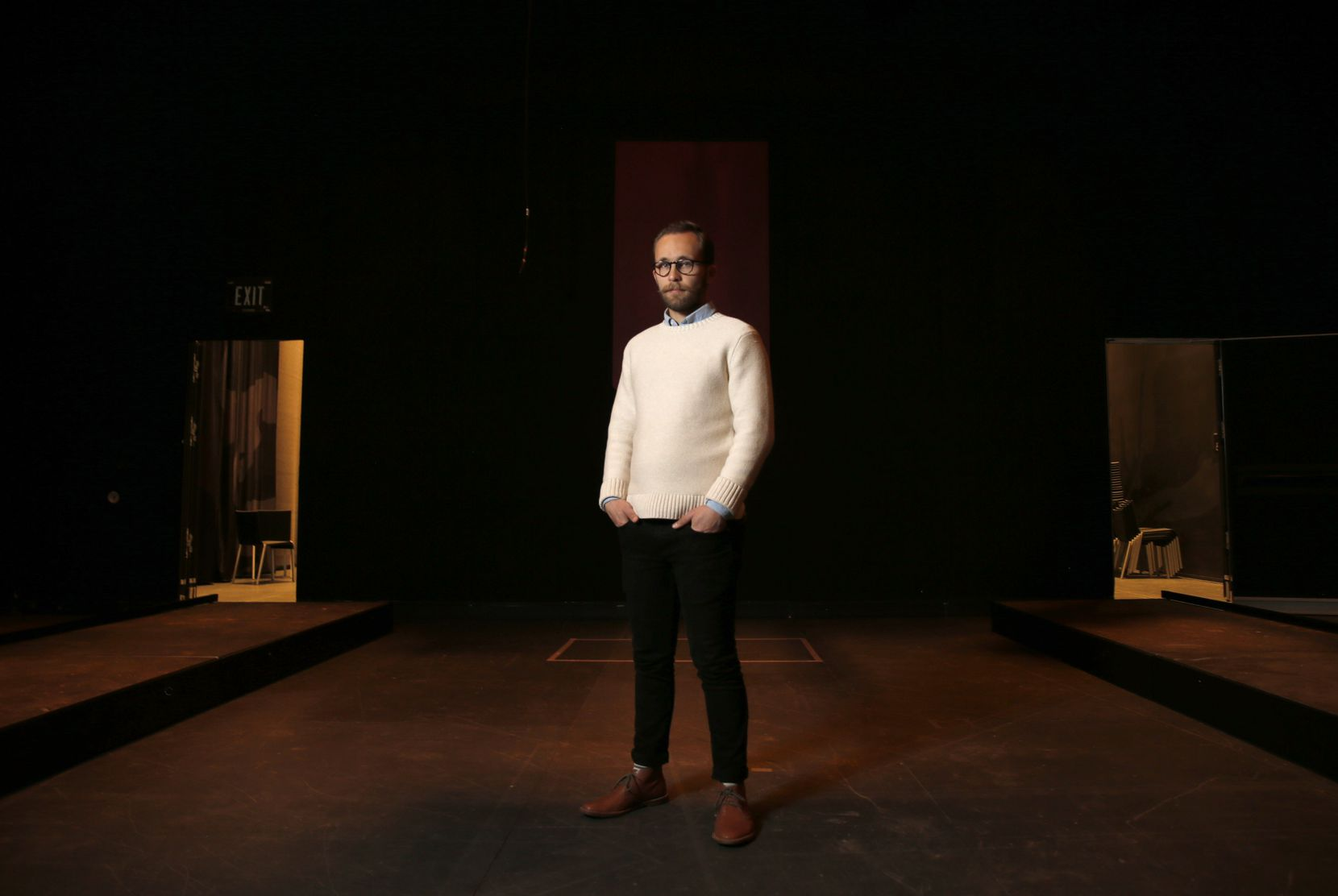 """Jake Nice, director of the play, """"Slide By,"""" poses for a portrait in the Studio Theatre at Wyly Theatre in Dallas on Tuesday, January 7, 2020."""