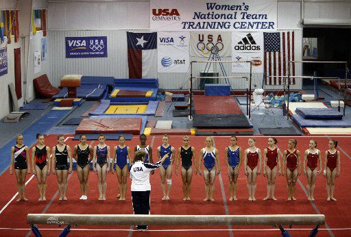 Gymnasts line up on the floor at the end of a training session in 2008 to listen to Martha Karolyi, then-national team coordinator, at the Karolyi Ranch near New Waverly.