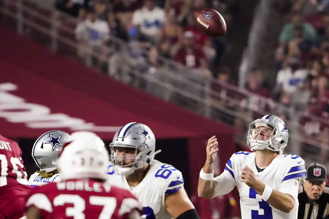 Dallas Cowboys quarterback Garrett Gilbert (3) reaches for a high snap during the first quarter of an NFL football game at State Farm Stadium on Friday, Aug. 13, 2021, in Glendale, Ariz.