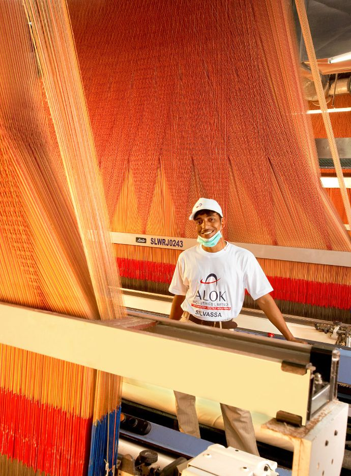 Dallas-based Nextt has its textile products manufactured by partner Alok International, in India. The huge weaving plant is the world's largest under one roof, covering 14 acres. Its 14,000 airjet weaving looms produce 1.6 million linear feet of fabric a day.