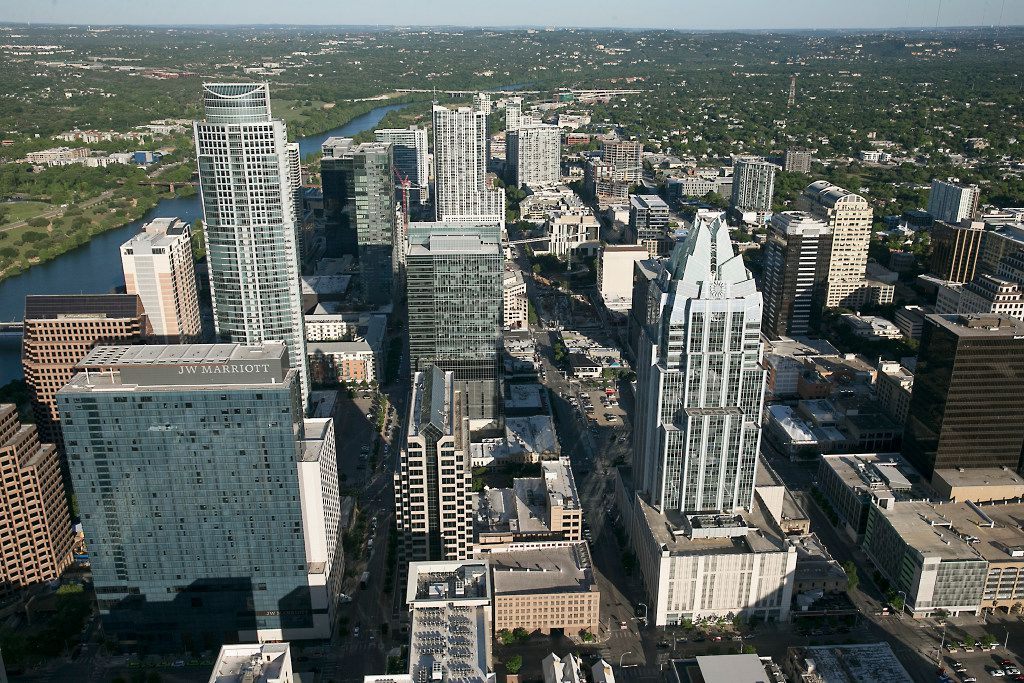 An aerial view of downtown Austin, including the Frost Bank Tower and the J.W. Marriott Hotel.