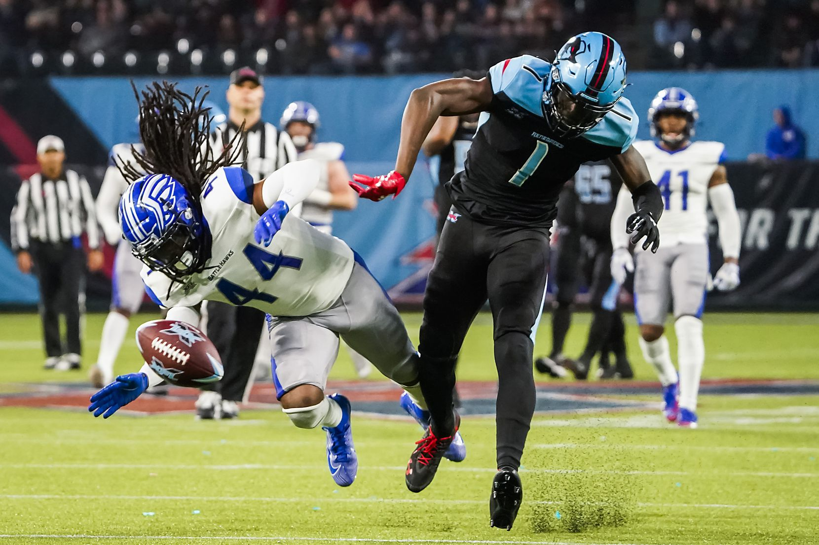 Dallas Renegades wide receiver Jazz Ferguson (1) has a pass sail out of reach as St. Louis Battlehawks safety Joe Powell (44) defends during the second half of an XFL football game at Globe Life Park on Sunday, Feb. 9, 2020, in Arlington.