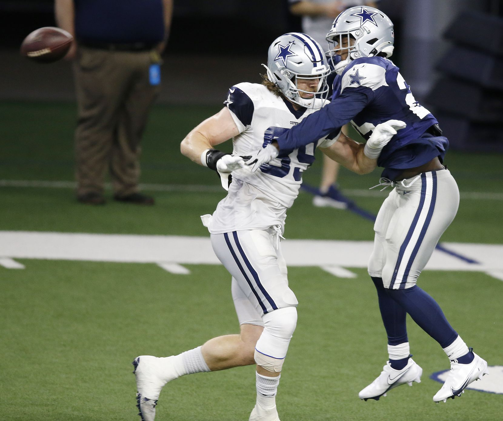 Dallas Cowboys safety Xavier Woods (25) breaks up a pass intended for Dallas Cowboys tight end Blake Jarwin (89) during training camp at the Dallas Cowboys headquarters at The Star in Frisco, Texas on Thursday, August 27, 2020. (Vernon Bryant/The Dallas Morning News)