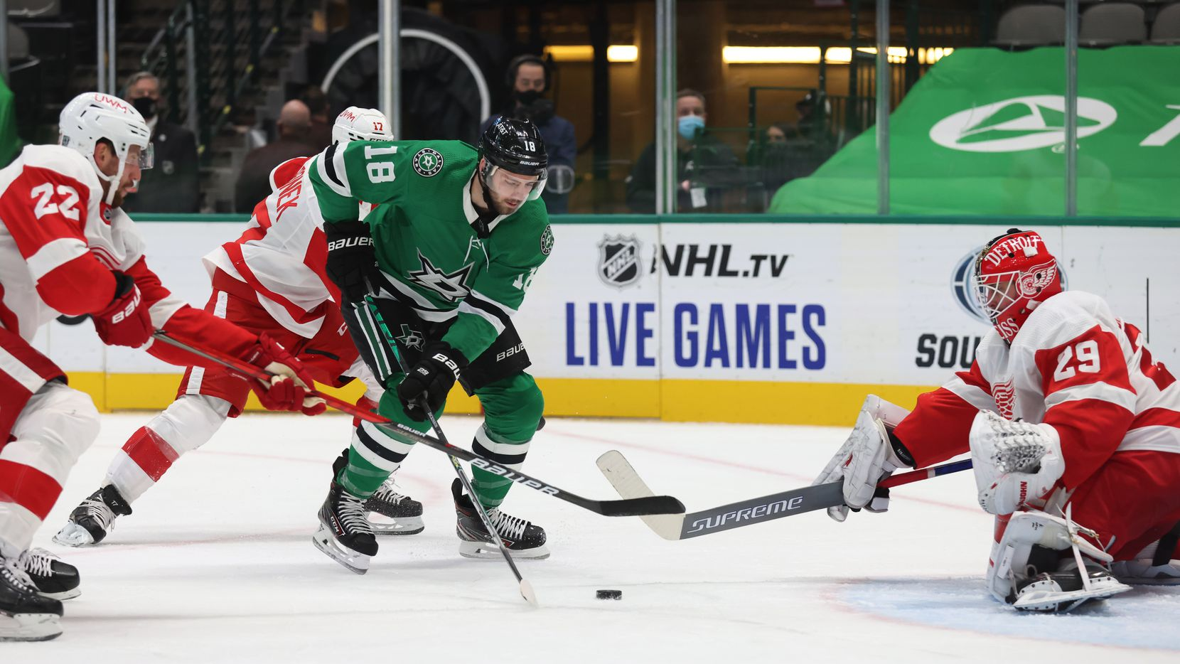 Dallas Stars center Jason Dickinson (18) looks to shoot as Detroit Red Wings defenseman Patrik Nemeth (22) and Detroit Red Wings goaltender Thomas Greiss (29) defend the goal during the first period of play at American Airlines Center on Tuesday, January 26, 2021 in Dallas.