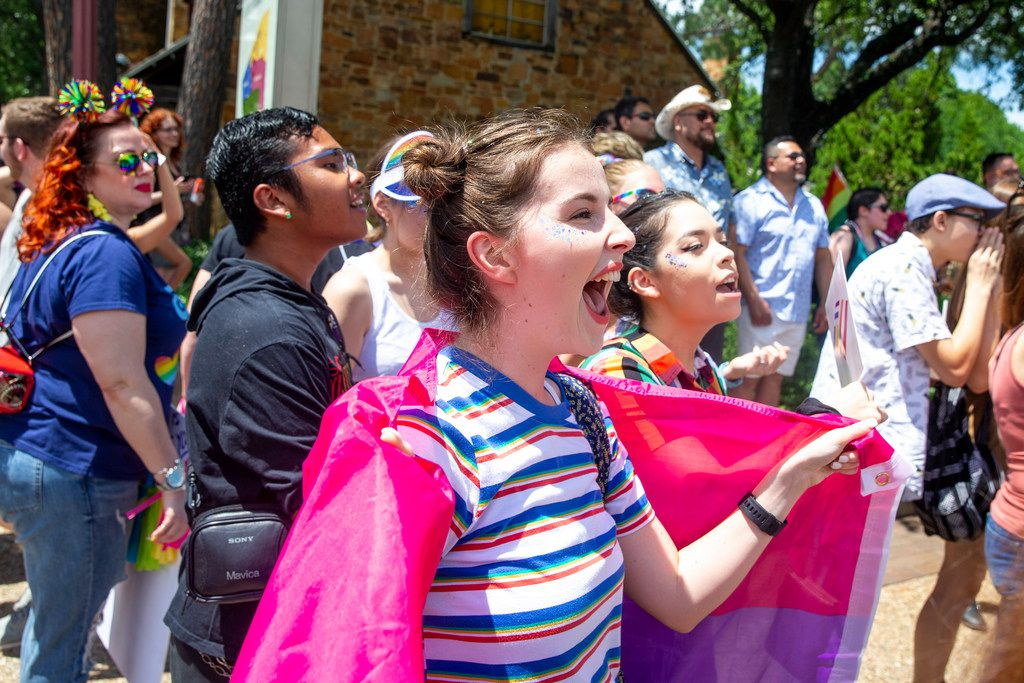 Kyleigh Whitsell, 20, of Grapevine, Texas, cheers as the parade goes by during the annual Dallas Pride / Alan Ross Texas Freedom Parade at Fair Park in Dallas on Sunday, June 2, 2019. (Shaban Athuman/Staff Photographer)