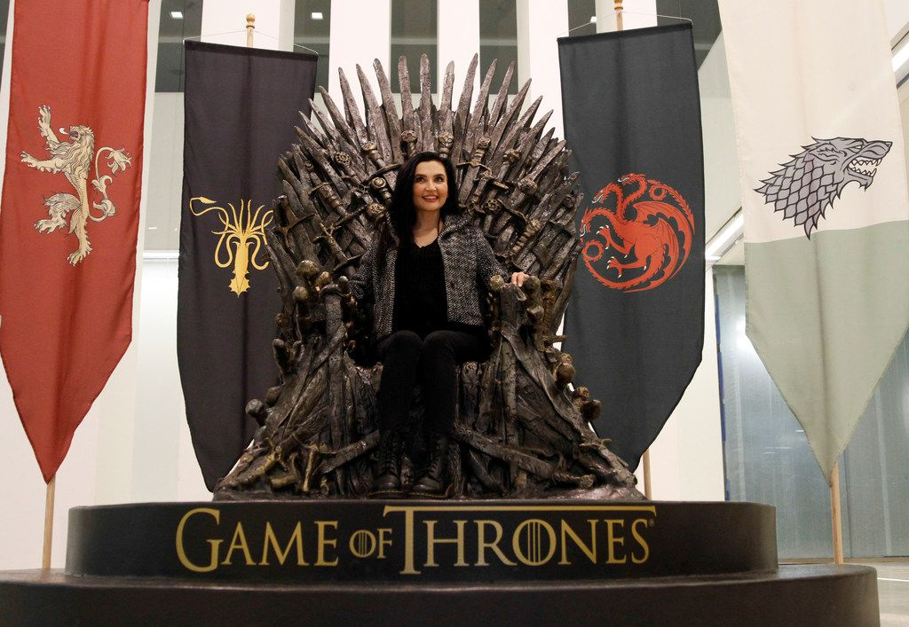 """Denisa Ulloa of Dallas sits in a replica of the Iron Throne from the HBO TV series """"Game of Thrones"""" set up in the headquarters of AT&T in downtown Dallas."""