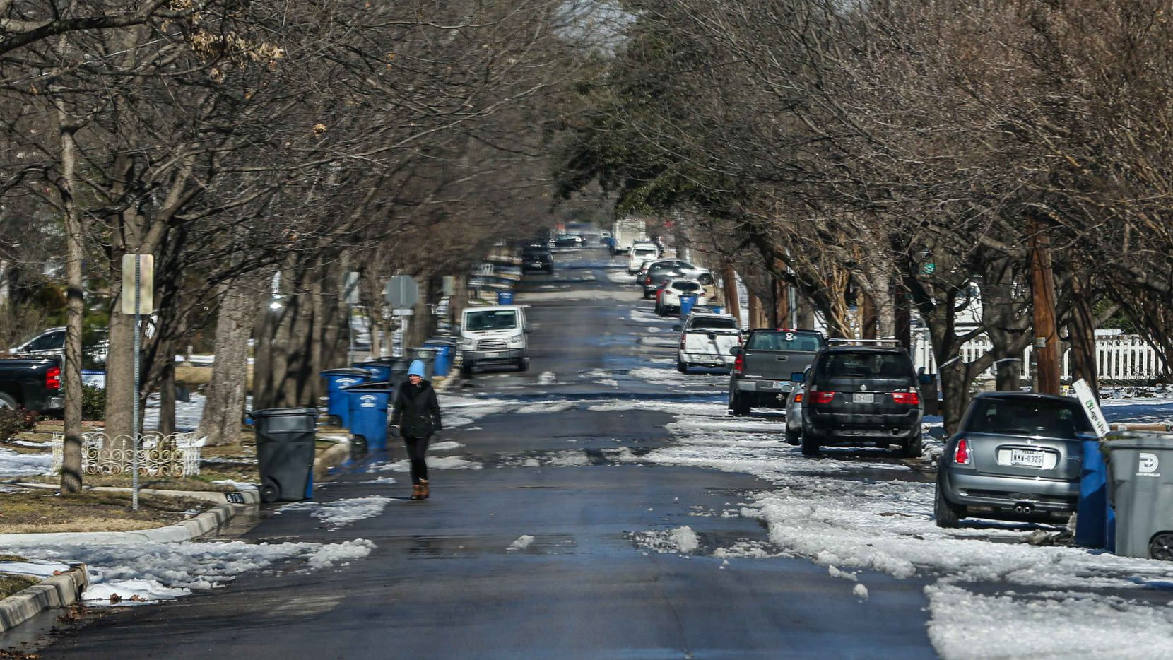 North Texas has begun to thaw out from the week's freezing weather, but trouble such as lingering power outages and boil-water notices remain. Above is a scene from Dallas' Swiss Avenue on Friday, Feb. 19, 2021.