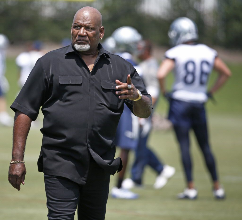 """FILE — Former Dallas linebacker Thomas """"Hollywood"""" Henderson is pictured during a Cowboys' practice at the Star in Frisco, June15, 2017. Henderson, 67, recently received his two Pfizer vaccine shots and is encouraging others to do the same as soon as they can."""