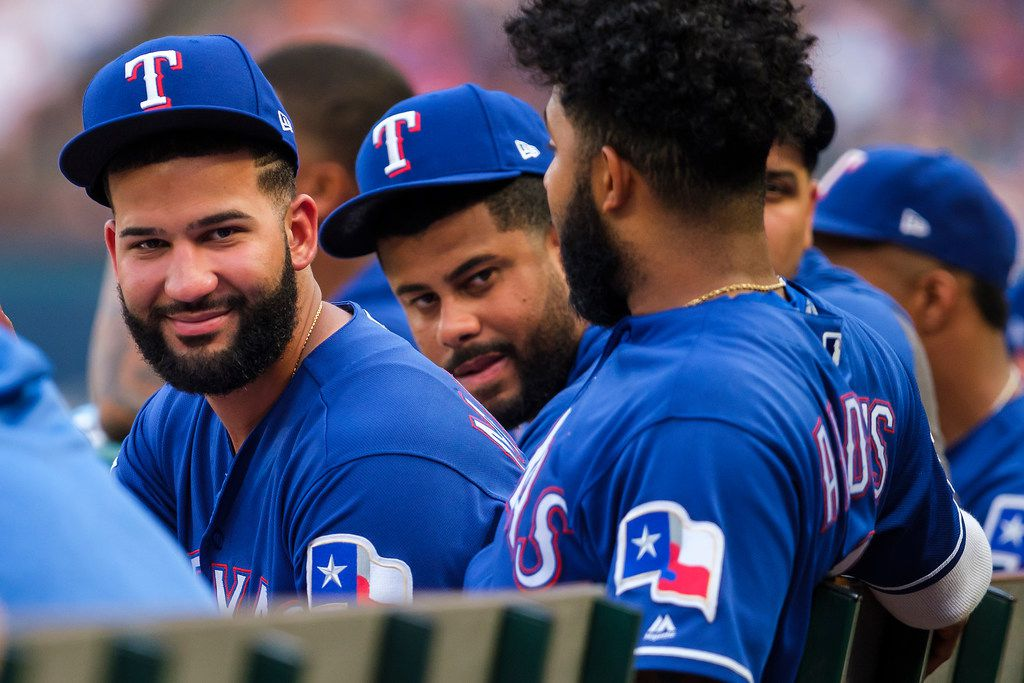 Texas Rangers outfielder Nomar Mazara (left) watches from the dugout with shortstop Elvis Andrus during the second inning against the Detroit Tigers at Globe Life Park on Friday, Aug. 2, 2019, in Arlington. (Smiley N. Pool/The Dallas Morning News)