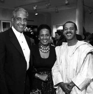 Mohamed Toure (right) is shown at the grand opening of his wife's store, Out of Africa, in December 1994.