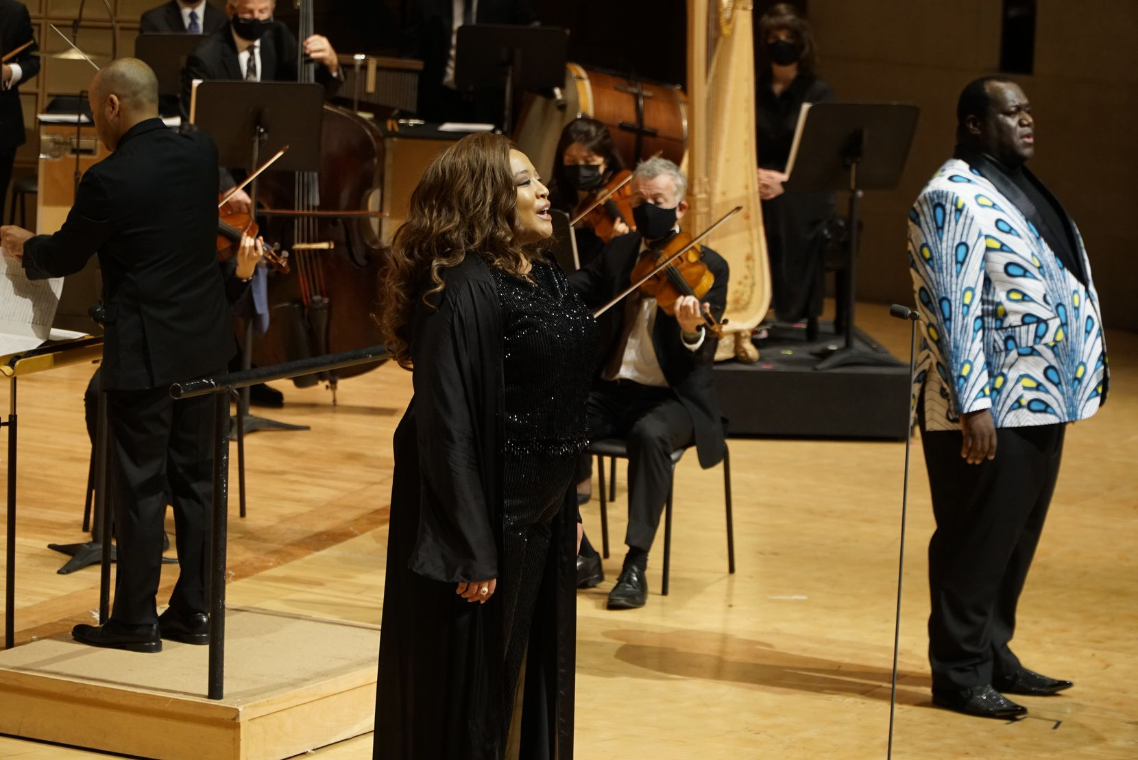 """Michelle Bradley and Reginald Smith Jr. sing """"Lift Every Voice and Sing"""" with the Dallas Symphony Orchestra at the Meyerson Symphony Center in Dallas on Nov. 11."""